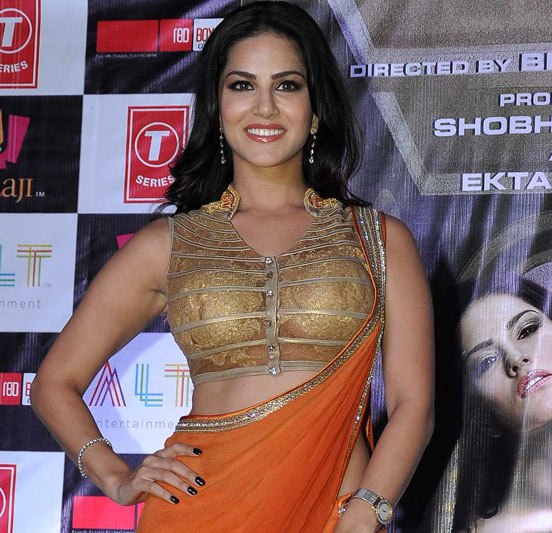 Image result for sunny leone in orange saree
