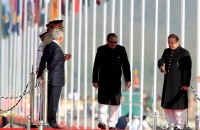 Prime Minister Nawaz Sharif (R) and President Mamnoon Hussain (C) arrive to attend the Pakistan Day military parade in Islamabad