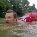 Man Goes to Work by Swimming in River