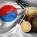Stack of Bitcoin coins on South Korean flag